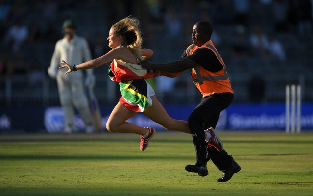 A female pitch invader is caught by a steward during Day Two of the Fourth Test between South Africa and England at Wanderers on January 25, 2020 in Johannesburg, South Africa. (Photo by Stu Forster/Getty Images)