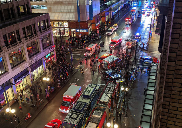This handout image taken by Nikesh Parekh and posted on his Twitter account shows police activity at the scene of a shooting which left one dead and five injured on 4th Avenue and Pine street in downtown Seattle, Washington State on January 22, 2020. The Seattle Police Department is searching for a gunman who left one dead and five injured on January 22, 2020, evening before fleeing the scene. (Photo by Nikesh Parekh/AFP Photo)