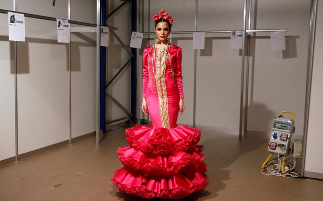 A model poses for a portrait backstage as she wears a creation by Calandria during the International Flamenco Fashion Show SIMOF in the Andalusian capital of Seville, Spain on February 1, 2020. (Photo by Marcelo del Pozo/Reuters)