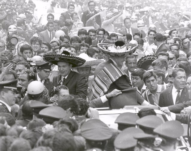 The Apollo 11 astronauts, Neil A. Armstrong, Edwin E. Aldrin, Jr., and Michael Collins, wearing sombreros and ponchos, are swarmed by thousands in Mexico City as their motorcade is slowed by the enthusiastic crowd. The GIANTSTEP-APOLLO 11 Presidential Goodwill Tour emphasized the willingness of the United States to share its space knowledge. The tour carried the Apollo 11 astronauts and their wives to 24 countries and 27 cities in 45 days. (Photo by NASA)