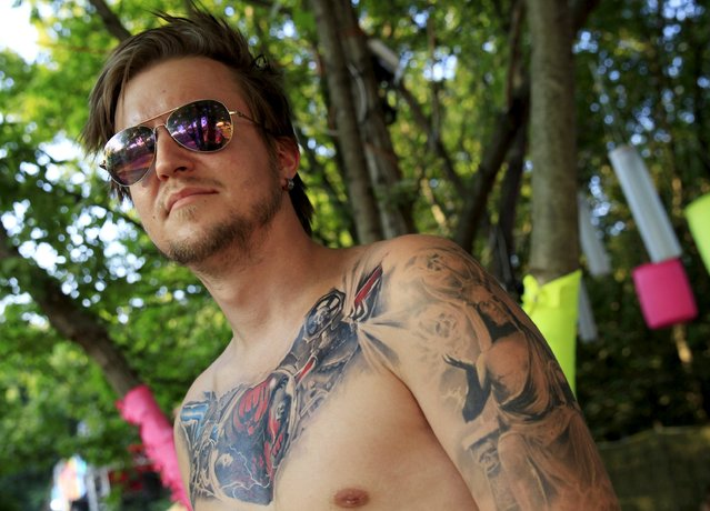 Joonas Nikander, 24, from Finland shows his tattoo during the Sziget music festival on an island in the Danube River in Budapest, Hungary, August 14, 2015. (Photo by Bernadett Szabo/Reuters)