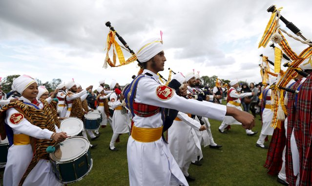 Members of the Sri Dasmesh Pipe Band from Malaysia march out of the arena after competing in the annual World Pipe Band Championships at Glasgow Green, Scotland August 15, 2015. The event includes some 230 pipe bands from all around the world. (Photo by Russell Cheyne/Reuters)