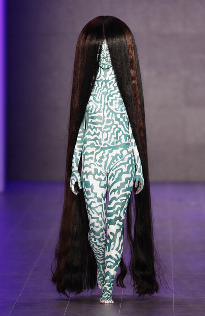 A model walks the runway at the Dare By Johny Dar show during the Mercedes-Benz Fashion Week Spring/Summer 2015 at Erika Hess Eisstadion on July 11, 2014 in Berlin, Germany. (Photo by Peter Michael Dills/Getty Images for IMG)
