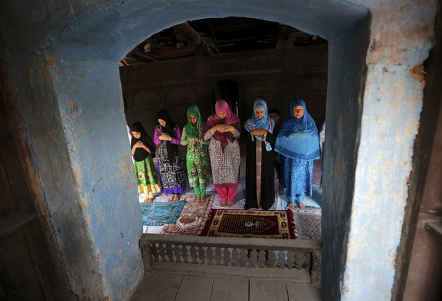 Kashmiri Muslim women offer prayers inside a house during Jumat-ul-Vida or the last Friday of the holy month of Ramadan outside Jamia Masjid in Srinagar July 1, 2016. (Photo by Danish Ismail/Reuters)