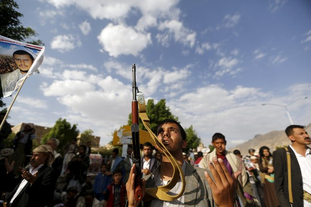 A Houthi militant recites prayers during a demonstration against the Saudi-led air strikes in Yemen's capital Sanaa August 24, 2015. The nothern-based Houthis, a Shi'ite Muslim group, took control of Sanaa last September. Arab countries intervened in the conflict in March to halt a Houthi advance into the south which caused the Saudi-backed government to flee to Riyadh from its refuge in the southern port of Aden. (Photo by Khaled Abdullah/Reuters)