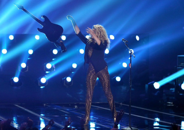 Tori Kellythrows her guitar as she performs at the MTV Video Music Awards at the Microsoft Theater on Sunday, August 30, 2015, in Los Angeles. (Photo by Matt Sayles/Invision/AP Photo)