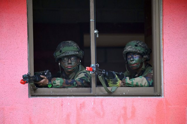 """South Korean soldiers participate in a South Korea-US combined arms collective training exercise at the US army's Rodriguez shooting range in Pocheon, about 70 km northeast of Seoul near the heavily-fortified border with North Korea on September 19, 2017. North Korea bitterly denounced new sanctions on its economy as """"vicious, unethical and inhumane"""" and warned the measures would only accelerate progress on its nuclear weapons programme, state media reported. (Photo by Jung Yeon-Je/AFP Photo)"""