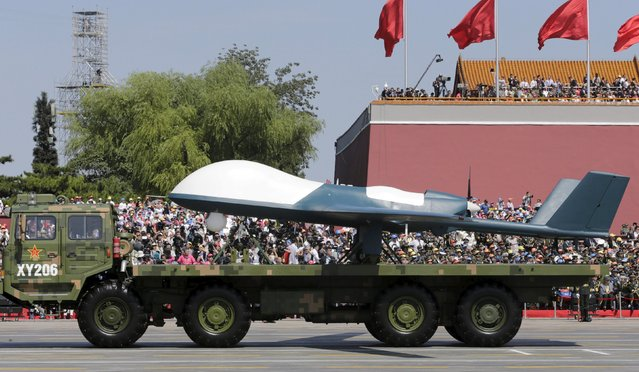 A military vehicle carrying a Pterodactyl I unmanned aerial vehicle drivess past the Tiananmen Gate during a military parade to mark the 70th anniversary of the end of World War Two, in Beijing, China, September 3, 2015. (Photo by Jason Lee/Reuters)