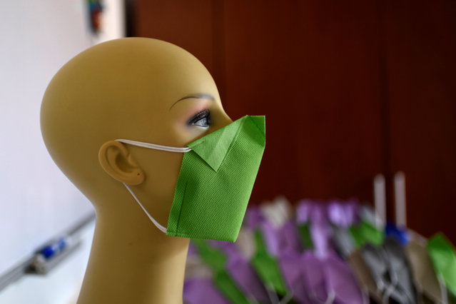 A mannequin shows a face mask produced by clothing designers Stalina Svieykowsky and Nelson Jimenez in response to the coronavirus disease (COVID-19), in San Antonio de los Altos, Venezuela on March 18, 2020. (Photo by Carolina Cabral/Reuters)