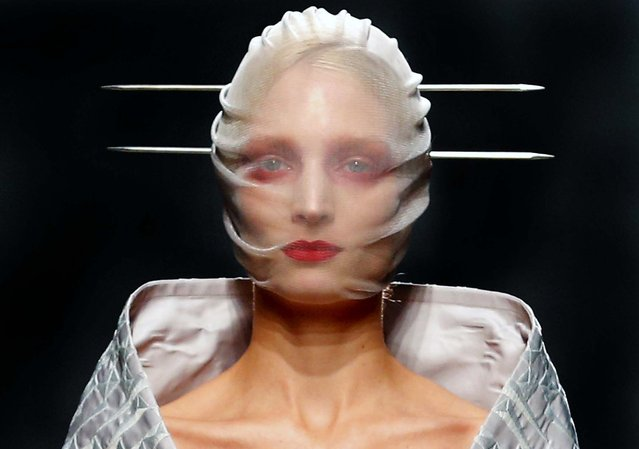 A model wears a creation by British fashion designer Gareth Pugh for the fashion house's Spring Summer 2013 ready to wear collection, during Fashion Week in Paris, on September 26, 2012. (Photo by Jacques Brinon/Associated Press)