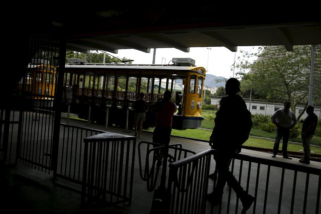 People enter a station to board the bonde, the typical tram line in Santa Teresa neighborhood in Rio de Janeiro, Brazil, September 9, 2015. (Photo by Pilar Olivares/Reuters)