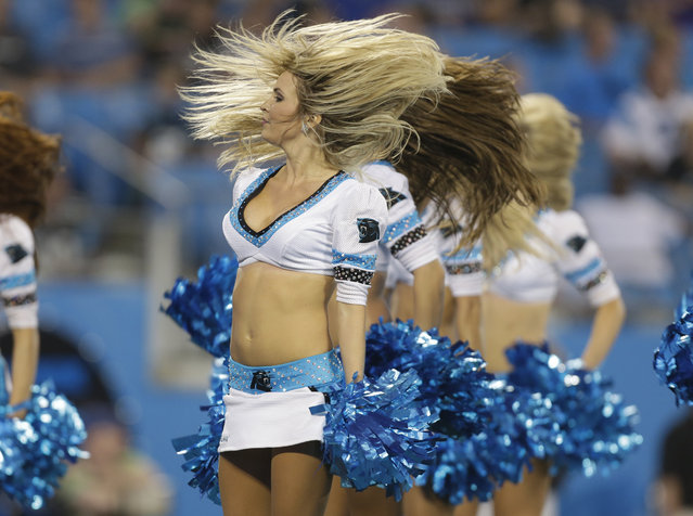 Carolina Panthers cheerleaders perform during the second half of a preseason NFL football game against the Buffalo Bills in Charlotte, N.C., Friday, August 8, 2014. The Bills won 20-18. (Photo by Bob Leverone/AP Photo)