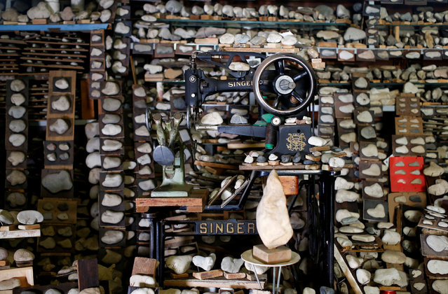 A shoemaking machine is surrounded by the stone collection of Luigi Lineri at his home workshop in Zevio, near Verona, Italy, June 10, 2016. (Photo by Alessandro Bianchi/Reuters)
