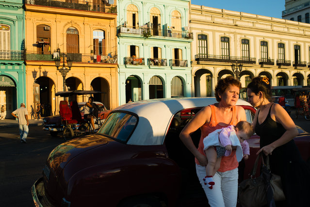 People get out of a taxi in the Old Havana Neighborhood. (Photo by Sarah L. Voisin/The Washington Post)