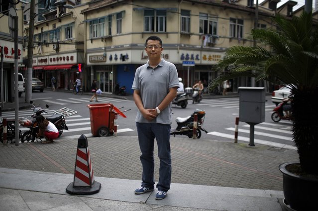 "Zhang Bowen, who was born in 1985, poses for a photograph in Shanghai July 25, 2014. Bowen said: ""I'd like to have a sister or a brother, because I would feel less lonely growing up"". (Photo by Carlos Barria/Reuters)"