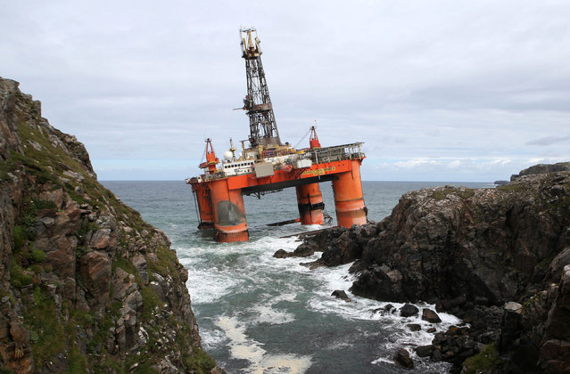 In this file photo dated October 9, 2016, showing the Transocean Winner drilling rig as it broke free from tug boats in rough seas and ran aground off the Isle of Lewis, Outer Hebrides, Scotland.  Final preparations are being made for high tide on Monday August 22, 2016, to re-float the 17,000-tonne oil rig carrying some 280 tons of diesel on board. (Photo by Andrew Milligan/PA Wire via AP Photo)
