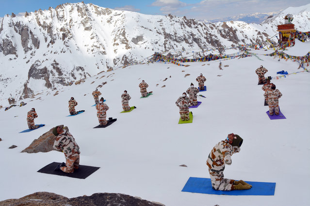 A handout photo made available by the Indo-Tibetan Border Police (ITBP) shows ITBP Force personnel performing Yoga in sub-zero temperatures, on the occasion of the International Day of Yoga, dubbed World Yoga Day, in Ladakh, India, 21 June 2020. The United Nations proclaimed 21 June as the International Day of Yoga, by its resolution 69/131 on 11 December 2014. (Photo by Indo Tibetan border police/EPA/EFE)