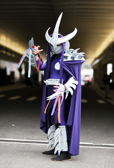 A Comic Con attendee poses as Shredder during the 2014 New York Comic Con at Jacob Javitz Center on October 10, 2014 in New York City. (Photo by Daniel Zuchnik/Getty Images)