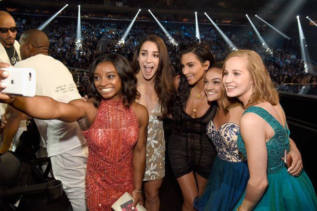 Olympic athletes Simone Biles, Aly Raisman, Laurie Hernandez and Madison Kocian pose for a selfie with Kim Kardashian at the MTV Video Music Awards at Madison Square Garden on Sunday, August 28, 2016, in New York. (Photo by Kevin Mazur/WireImage)