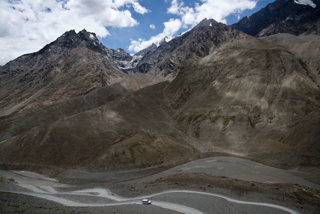 In this August 15, 2016, photo, a jeep drives along the only road that leads to Spiti Valley, a remote Himalayan valley situated at 4000 meter above sea level, India. (Photo by Thomas Cytrynowicz/AP Photo)