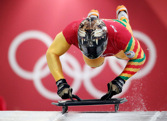 Akwasi Frimpong of Ghana starts his practice run during the men' s skeleton training at the 2018 Winter Olympics in Pyeongchang, South Korea, Wednesday, February 14, 2018. (Photo by Arnd Wiegmann/Reuters)