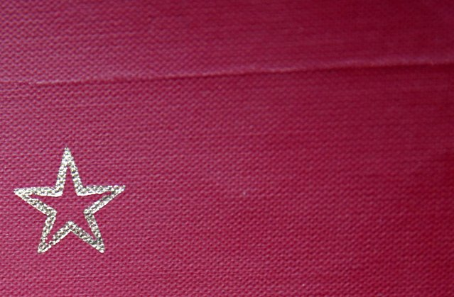 A partisan star is seen on a book cover in Josip Broz Tito's underground secret bunker (ARK) in Konjic, October 16, 2014. (Photo by Dado Ruvic/Reuters)