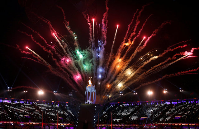 The Paralympic flame is seen during fireworks at the opening ceremony for the XII Paralympic Winter Games in the PyeongChang Olympic Stadium, PyeongChang, South Korea, Friday, March, 9, 2018. (Photo by Paul Hanna/Reuters)