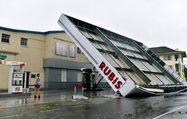 A gas station on Bay Street is toppled due to Hurricane Matthew striking Nassau, Bahamas October 6, 2016. (Photo by Dante Carrer/Reuters)