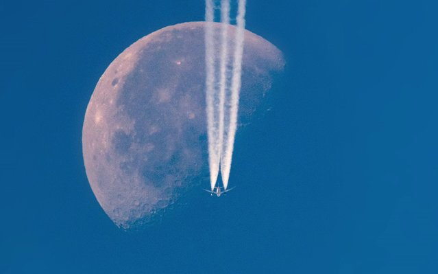 American Airlines Flight AA25 from Munich to Dallas passes the Waning Gibbous moon on September 20, 2019 in Stalybridge, England. (Photo by Anthony Devlin/Getty Images)