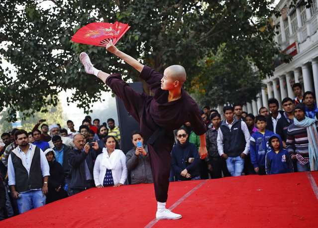 A member of the Kung Fu Nuns performs a self-defence manoeuvre during an event in New Delhi, December 7, 2014. (Photo by Anindito Mukherjee/Reuters)