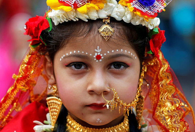 A Hindu girl dressed as a Kumari, poses for a picture as she arrives to attend the rituals to celebrate the Navratri festival at Adyapeath temple on the outskirts of Kolkata, March 25, 2018. (Photo by Rupak De Chowdhuri/Reuters)