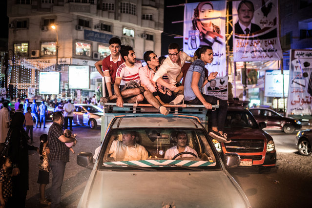 Egyptians take part in a rally to support a candidate for the upcoming parliamentary vote in Minya, Egypt on October 15, 2015. Egypt's long-awaited election will be conducted in two stages covering the country's 27 provinces. (Photo by Pan Chaoyue/Xinhua Press/Corbis)
