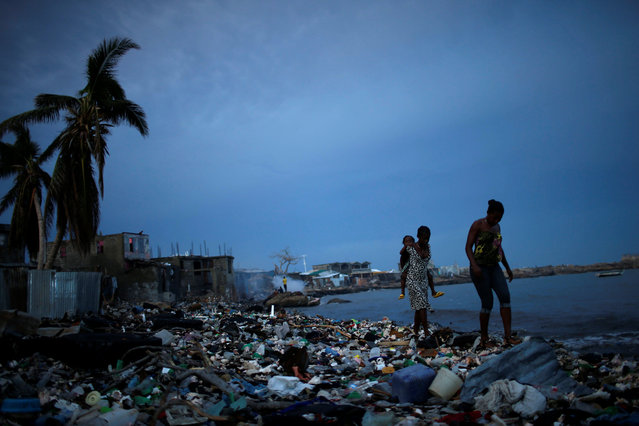 People walk on the beach after Hurricane Matthew hit Jeremie, Haiti, October 16, 2016. (Photo by Carlos Garcia Rawlins/Reuters)