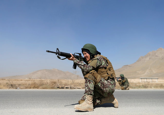 Zarmina Ahmadi, 22, a female soldier from the Afghan National Army (ANA) aims her rifle during a military exercise at the Kabul Military Training Centre (KMTC) in Kabul, Afghanistan October 26, 2016. Kabul's military training academy is churning out classes of enthusiastic women to serve in Afghanistan's army, but the realities of rising violence and a conservative society make the future for the young recruits far from certain. In the latest class, some of the nearly 150 women training to be officers say they feel proud to be part of the effort to secure the country, still racked by an insurgency waged by Islamist militants to topple the Western-backed government. (Photo by Mohammad Ismail/Reuters)