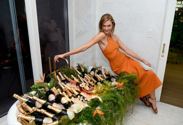 Model Karlie Kloss attends Raspoutine Paris Pop-up at L'Eden by Perrier Jouet at the Faena Hotel on December 2, 2015 in Miami, Florida. (Photo by Andrew Toth/Getty Images for Pernod Ricard USA)