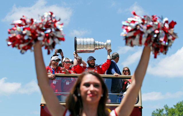 Washington Capitals left wing Alex Ovechkin hoists the Stanley Cup during the Stanley Cup championship parade and celebration in Washington, DC, USA on June 12, 2018. (Photo by Alex Brandon/Pool Photo via USA TODAY Sports)