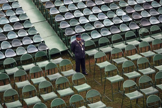 An Indian Air Force (IAF) officer stands amid empty chairs installed at the venue of the Republic Day parade in New Delhi January 23, 2015. (Photo by Adnan Abidi/Reuters)