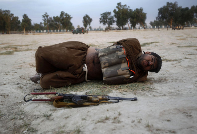 A suicide attacker lies on the ground after his vest was defused in Jalalabad province June 30, 2013. Afghan security forces captured a would-be suicide attacker before he blew himself up in Jalalabad on Sunday. (Photo by Reuters/Parwiz)