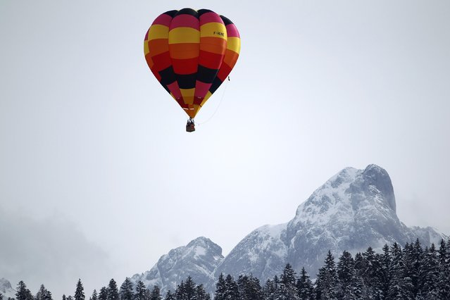 A balloon flies during the 37th International Hot Air Balloon Week in Chateau-d'Oex, January 24, 2015. (Photo by Pierre Albouy/Reuters)