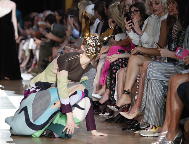 A model loses her balance as she wears a creation for Schiaparelli Haute Couture Fall-Winter 2018/2019 fashion collection presented Monday, July 2, 2018 in Paris, France. (Photo by Francois Mori/AP Photo)