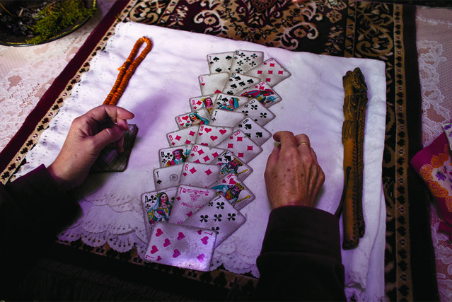 To guide their decision-making, the Kyrgyz often seek out shamans to read their fortune with cards in Talas, Kyrgyzstan, September 17, 2010. (Carolyn Drake/National Geographic)