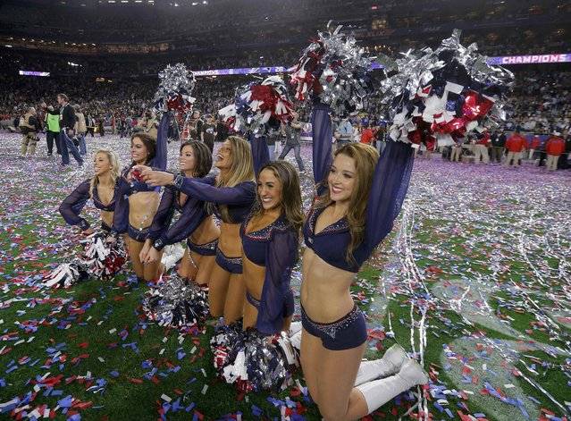 New England Patriots cheerleaders celebrate after their team defeated the Seattle Seahawks in the NFL Super Bowl XLIX football game in Glendale, Arizona February 1, 2015. (Photo by Brian Snyder/Reuters)