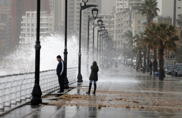 Residents stand by a crashing wave on Beirut's Corniche, a seaside promenade, as high winds sweep through Lebanon during a storm February 11, 2015. (Photo by Jamal Saidi/Reuters)