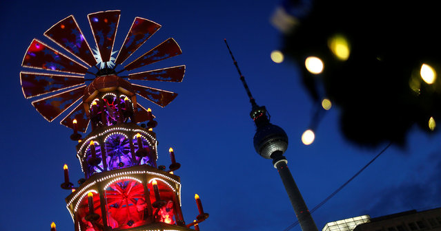 A Christmas pyramid is pictured next to the television tower at the Christmas market at Alexanderplatz square in Berlin, Germany November 21, 2016. (Photo by Hannibal Hanschke/Reuters)