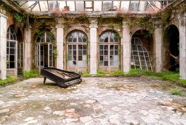 A piano abandoned in a house in Poland. (Photo by Roman Robroek/South West News Service)