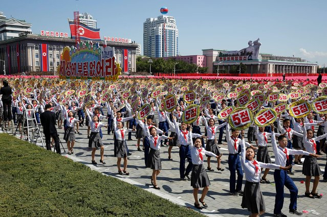 Participants march during a parade for the 70th anniversary of North Korea's founding day in Pyongyang, North Korea, Sunday, September 9, 2018. (Photo by Kin Cheung/AP Photo)