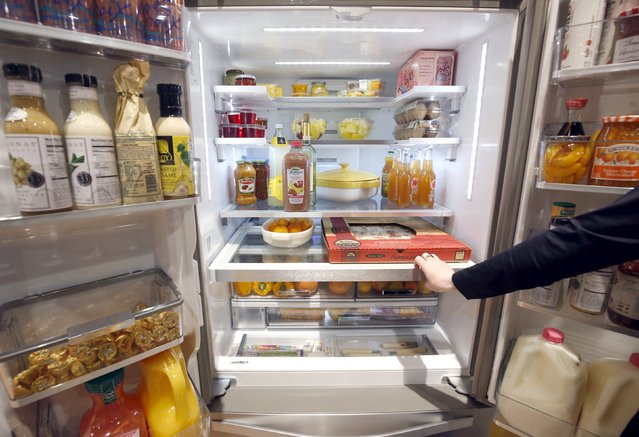 """A Whirlpool French Door refrigerator is shown during the 2016 CES trade show in Las Vegas, Nevada January 8, 2016. Innovation shelving design results in 30 percent more storage capacity, a representative said. The refrigerator also has a """"party-mode"""" that increases ice production and lowers the temperature. (Photo by Steve Marcus/Reuters)"""