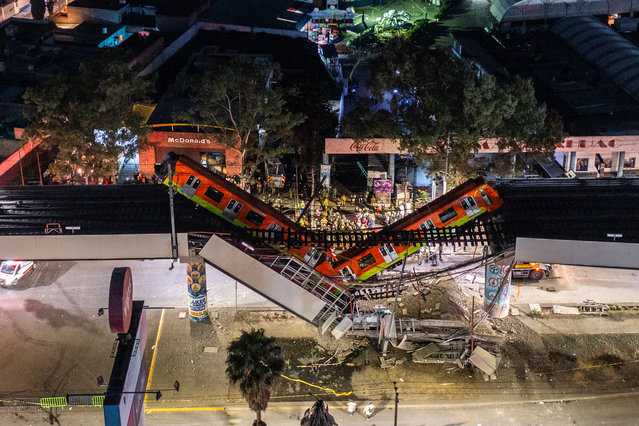 An aerial view of the scene after an elevated section of metro track in Mexico City, carrying train cars with passengers, collapsed onto a busy road on May 03, 2021 in Mexico City, Mexico. The Line 12 accident happened as the metro train was traveling between Olivos and Tezonco Metro stations, reportedly killing at least 20 people and injuring further 70. (Photo by Hector Vivas/Getty Images)