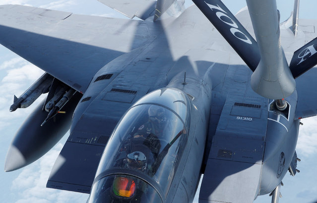 A F15 is refuelled by a U.S Air Force KC-135 during a European Tanker Symposium from RAF Mildenhall,  Britain May 17, 2018. (Photo by Darren Staples/Reuters)