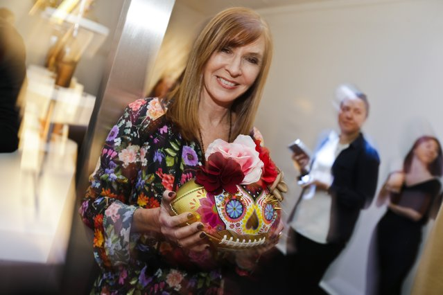 Fashion designer Nicole Miller poses for photographs while holding a football she designed at the unveiling of the CFDA footballs Wednesday, January 20, 2016, at the NFL headquarters in New York. (Photo by Frank Franklin II/AP Photo)
